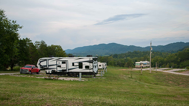 Campers set up at Sunset Cove with mountain views.
