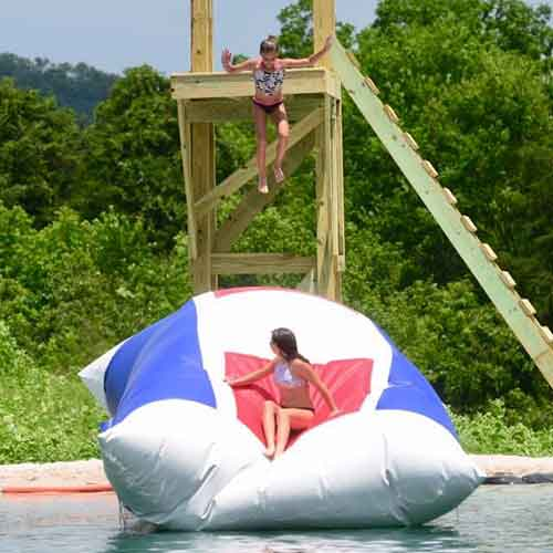 Kids jumping onto the Blob.